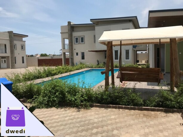 4bedroom-townhouse-with-swimming-pool-and-gym-centre-forrent-at-tse-addo-big-1